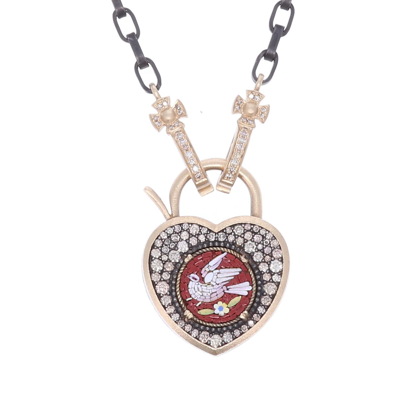 Rose Cut Diamond Cross Pendant, along with a Classic Heart Diamond Pendant and a Madonna