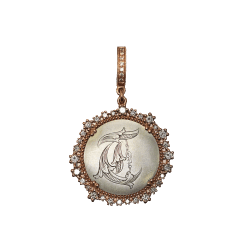 "Closeup photo of Rose Gold Love Token ""T"""