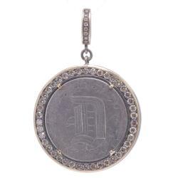 """Closeup photo of Love Token Engraved With """"D"""""""