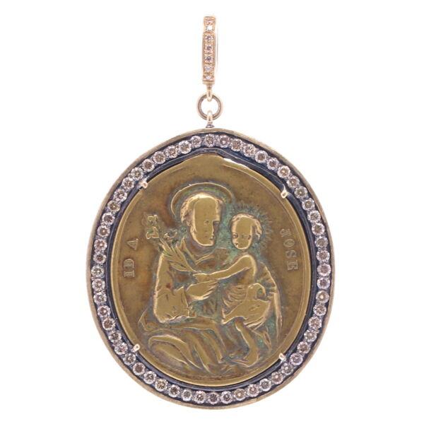 Closeup photo of Antique Spanish St. Joseph with Child Pendant