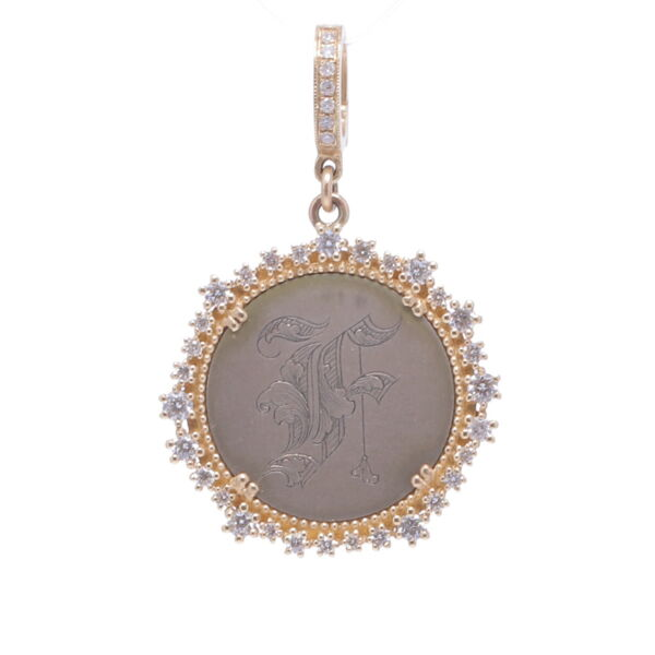 """Closeup photo of Love Token Engraved With """"F"""""""