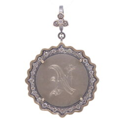 """Closeup photo of Love Token Engraved With """"N"""""""