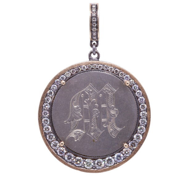"""Closeup photo of Love Token Engraved With """"M"""""""