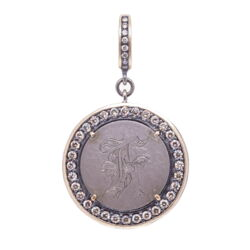 "Closeup photo of Love Token Pendant Engraved with ""F"""