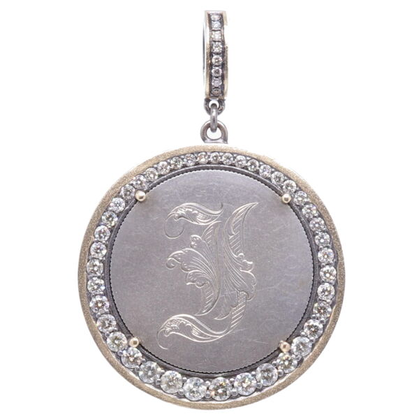 """Closeup photo of Love Token with Engraved """"I"""""""