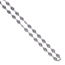 Closeup photo of Polished Cross Shield Chain With Black Diamond Stations 34""