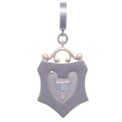 Closeup photo of Small Vintage English Padlock Heart Shield