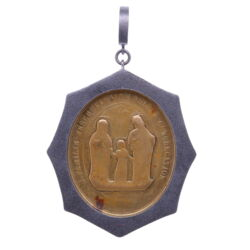 Closeup photo of German Family of Jesus, Mary, and Joseph Pendant