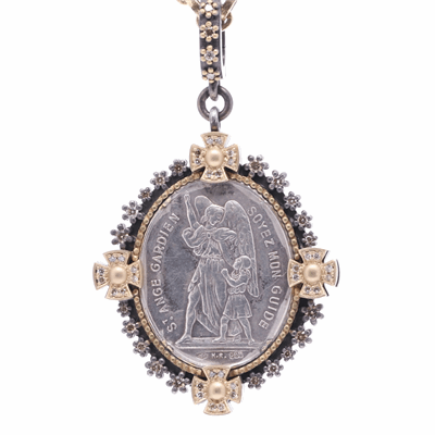Closeup photo of Antique Sterling Guardian Angel with 4 Cross Bezel