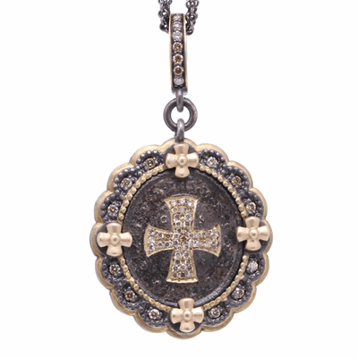 Closeup photo of Antique St Benedict with Scallop Mixed 4 Station Bezel