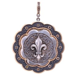 Closeup photo of Antique Sterling Fleur De Lis Pendant