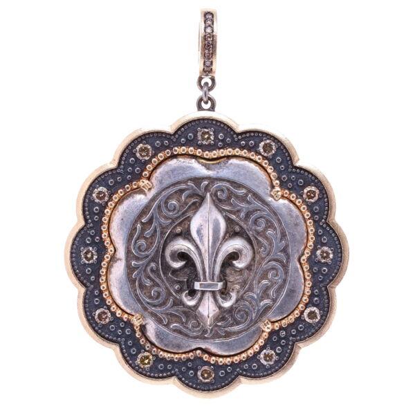 Closeup photo of Antique Sterling Fleur De Lis Pendant