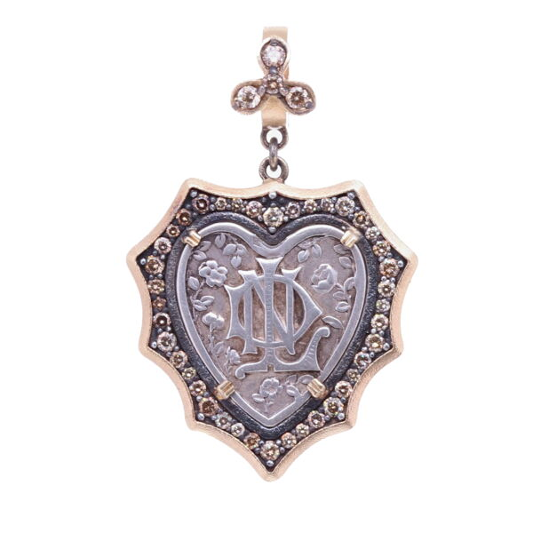 Closeup photo of French Notre Dame Heart Pendant