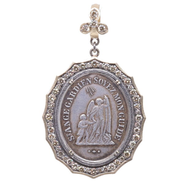 Closeup photo of 1800's French Guardian Angel Pendant