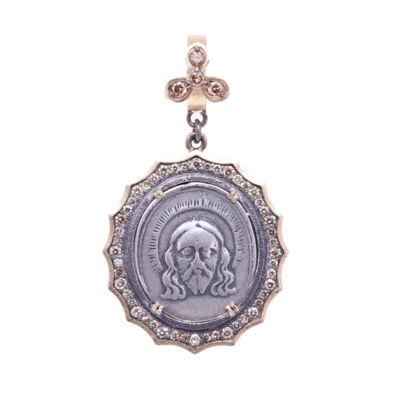 Closeup photo of 19th C. Christ and Lady of Guadalupe Pendant