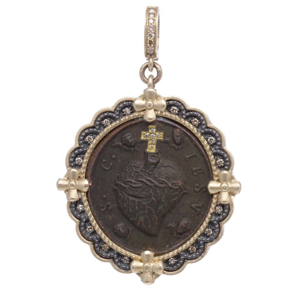 Closeup photo of Antique Sacred Heart with Cherubs Pendant