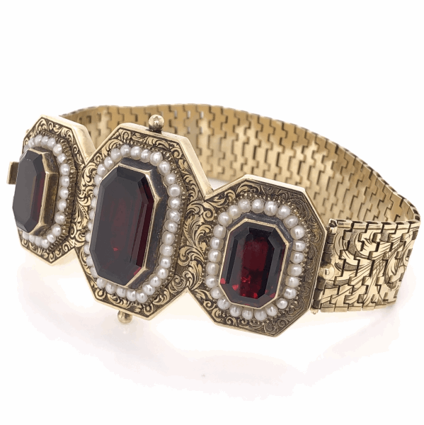 Closeup photo of 14k Victorian bracelet 3 emerald cut garnets and seed pearls engraved