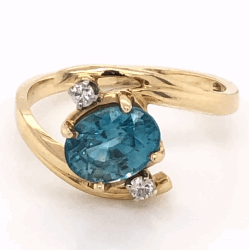 Closeup photo of 14K Yellow Gold 1.25ct Oval Blue Zircon Ring with .05tcw diamonds, 3.1g, s6