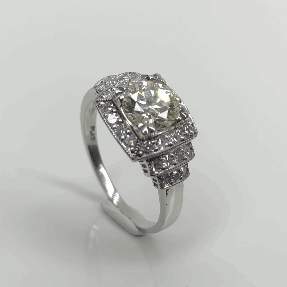 Platinum Art Deco 1.01ct OEC Diamond Ring with .30tcw side diamonds, Milgrain, s6.75