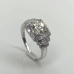 Closeup photo of Platinum Art Deco 1.01ct OEC Diamond Ring with .30tcw side diamonds, Milgrain, s6.75