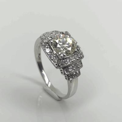 Closeup photo of Platinum Art Deco 1.01ct OEC Diamond Ring with .30tcw side diamonds, Milgrain, s6.75