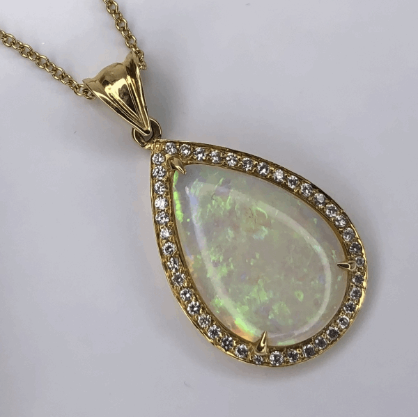 Closeup photo of 18K Yellow Gold 7.55ct Pear Shape White Opal Pendant, .44tcw diamonds, 16""