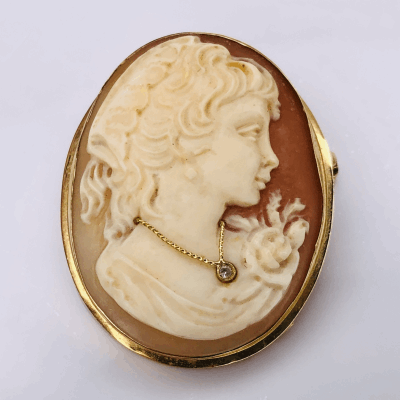 Closeup photo of 14K Yellow Gold Shell Cameo Brooch ,02ct Diamond on Necklace