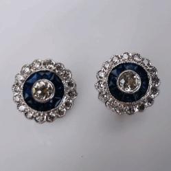 "Closeup photo of 18K White Gold Sapphire Halo Stud Earrings .72tcw diamonds, .50tcw sapphires .4"" diameter"