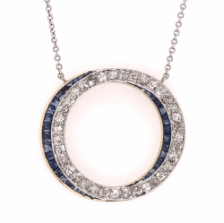 "Closeup photo of Platinum & 18K Yellow Gold Edwardian Open Double Circle Pendant 1.00tcw diamonds, .70tcw sapphires, c1900's, 16.5"" chain"