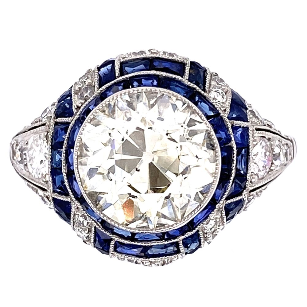 Platinum Art Deco 2.90 OEC Diamonds surrounded by .75tcw side diamonds and French cut sapphires