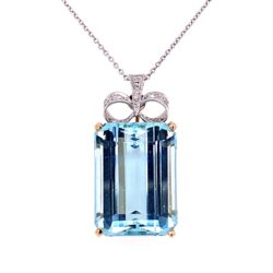 Closeup photo of 18K Two-tone 22.20ct Emerald Cut Aquamarine Pendant with Diamond Bow top .10tcw c1940's