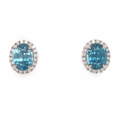 Closeup photo of 14K White Gold 7.45tcw Blue Zircon Stud Earrings with .39tcw Diamonds