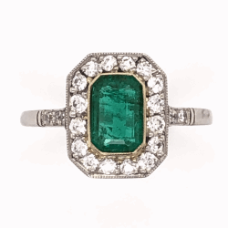 Closeup photo of Platinum Art Deco .85ct Emerald Cut Emerald Ring with .46tcw Diamonds, size 7