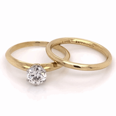 Closeup photo of 18K Yellow Gold TIFFANY & CO .55ct Round Brilliant Diamond Ring, size 5