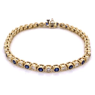 Closeup photo of 14K Yellow Gold Bezel Set Diamond & Sapphire Bracelet 13.2g, 7""