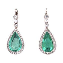 Closeup photo of Platinum Pear Emerald & Diamond Drop Earrings