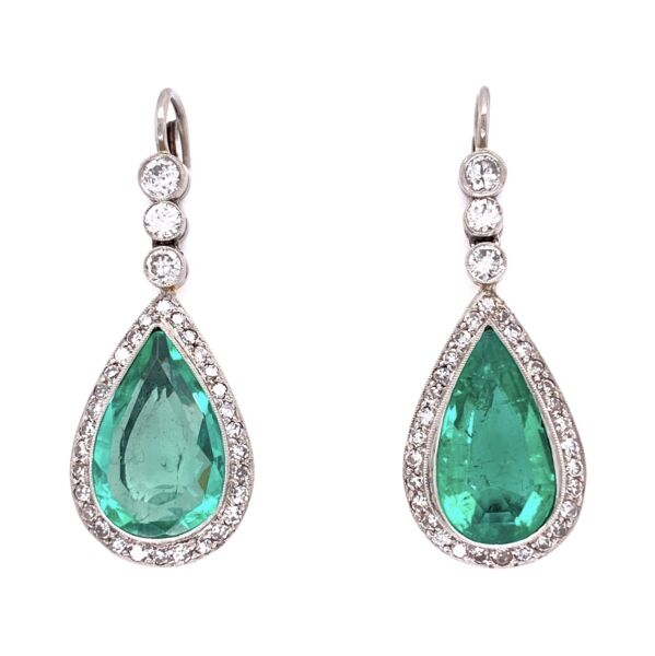 Closeup photo of Platinum Pear Emerald & Diamond Drop Earrings