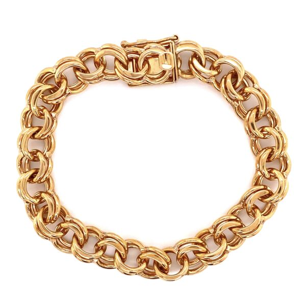 Closeup photo of 14K YG Link Charm Bracelet 31.2g, 7""