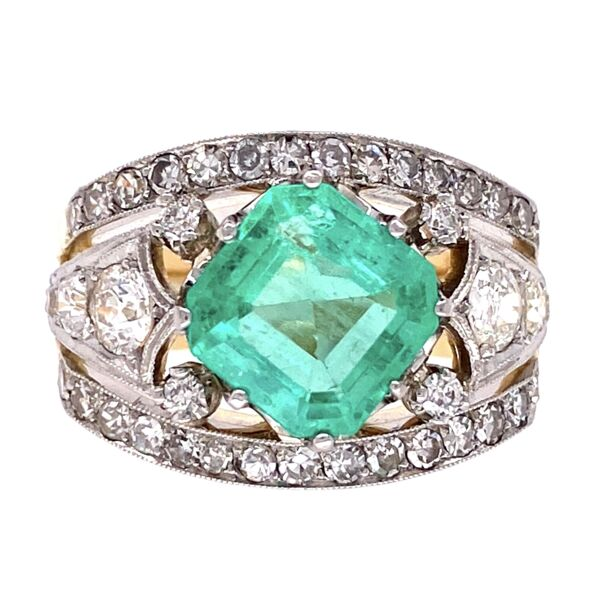 Closeup photo of Platinum on Gold Emerald & Diamond Ring