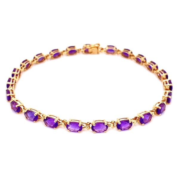 Closeup photo of 14K YG Oval Amethyst prong set Line Bracelet 7.4g, 8""