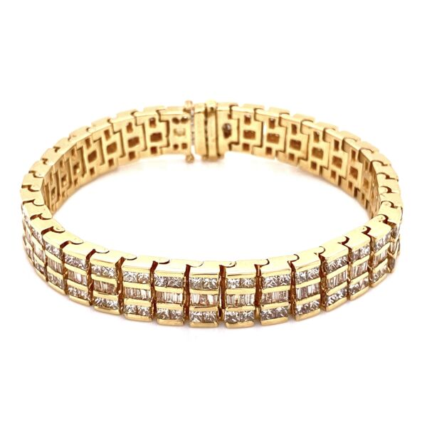 Closeup photo of 14K YG 3 row 9.00tcw Diamond Bracelet 47.1g, 7""