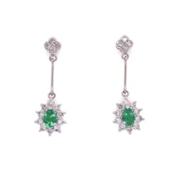 Closeup photo of Platinum Pear Shape Emerald Drop Earrings with .76tcw Diamonds