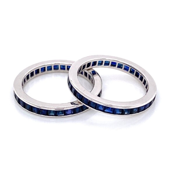 Closeup photo of Pair of 14K WG Syn. Blue Sapphire Eternity Bands 4.2g, s6+