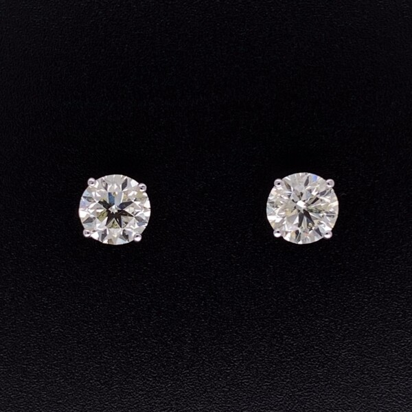 Closeup photo of 2.00tcw Round Brilliant Diamond Studs 6.3mm in 4 Prong Martini Post & Friction