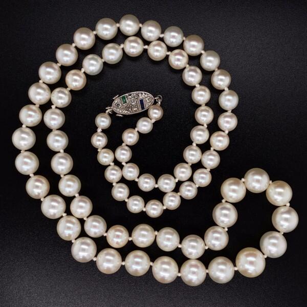 "Closeup photo of Platinum Mikimoto Art Deco Pearl Strand 8.7-4.7mm Diamonds, Emerald, Sapphire Clasp 21"""