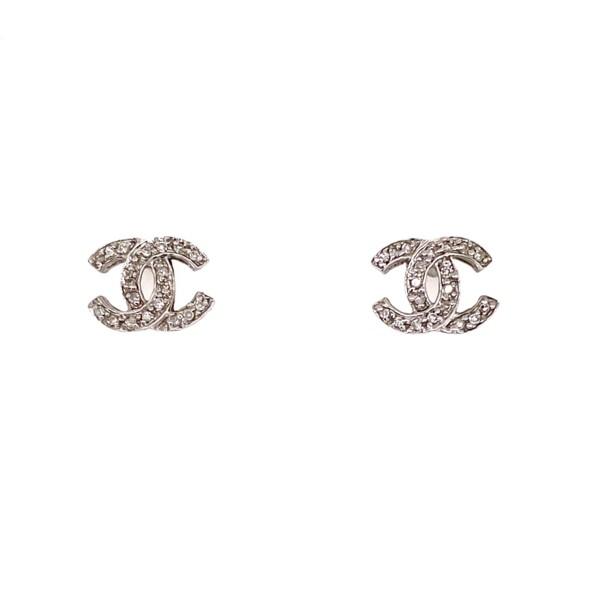 Closeup photo of 14K WG Chanel Style .20tcw Diamond Earrings 1.5g