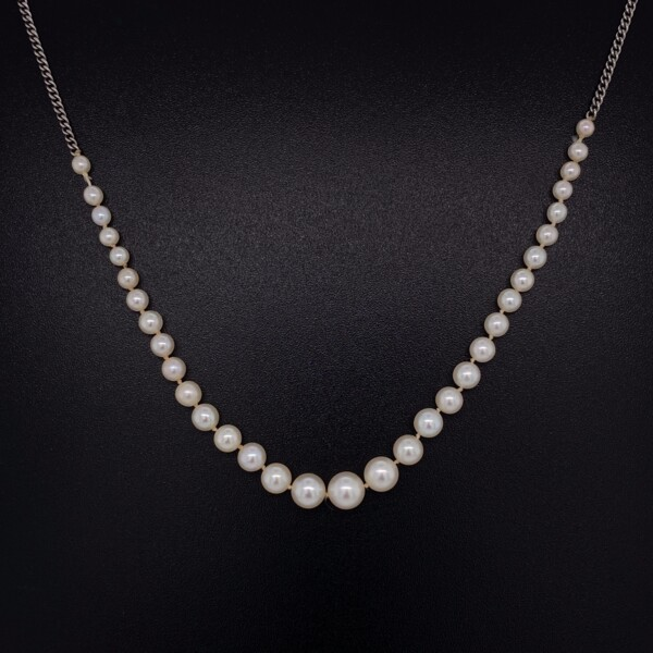 """Closeup photo of 14K WG Graduated 1/4 Pearl Necklace 4.8-2.3mm 3.3g, 16"""""""