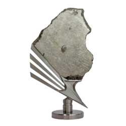 Closeup photo of Muonionalusta Meteorite Slice with Troylite Inclusion on Custom 'Icarus Shoe' Inspired Rotating Custom Stand 9.8kg Meteorite