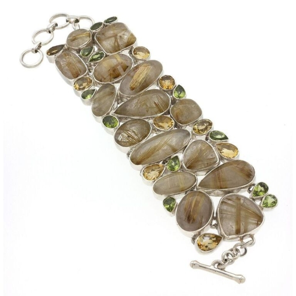 Closeup photo of Golden Rutile Bracelet With Peridot & Citrine