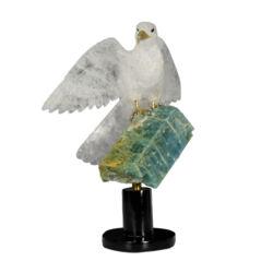 Closeup photo of Quartz Falcon On Aqaumarine Crystal Spinning Base